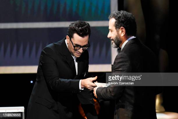 Daniel Levy presents Tony Shalhoub with the Outstanding Performance by a Male Actor in a Comedy Series for 'The Marvelous Mrs Maisel' onstage at the...