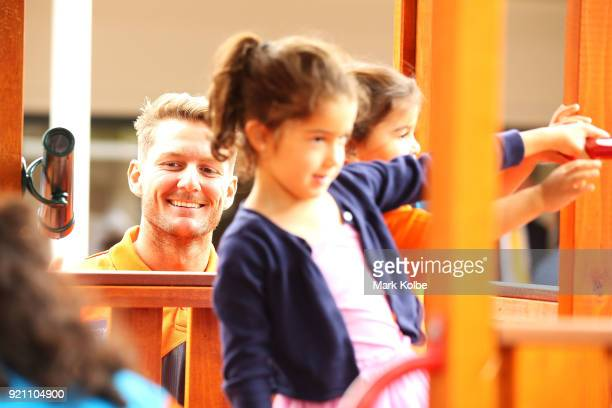 Daniel Lloyd interacts with children during a Greater Western Sydney Giants AFL media opportunity to launch their ÔLittle GIANTSÔ early education...