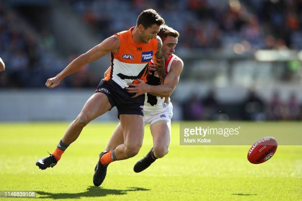 Daniel Lloyd of the Giants and Ben Paton of the Saints compete for the ball during the round seven AFL match between the Greater Western Sydney...