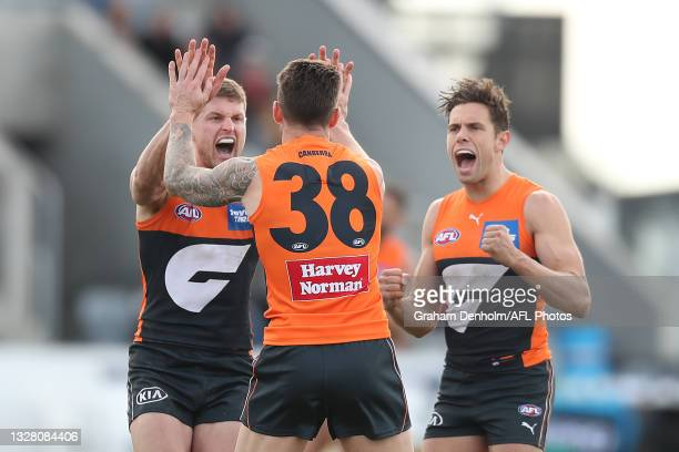Daniel Lloyd of the Giants celebrates kicking a goal during the round 17 AFL match between Greater Western Sydney Giants and Gold Coast Suns at Mars...