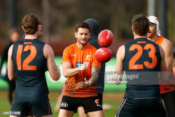 Daniel Lloyd of the Giants handballs during a Greater Western Sydney Giants AFL training session at Holden Centre on August 05, 2021 in Melbourne,...