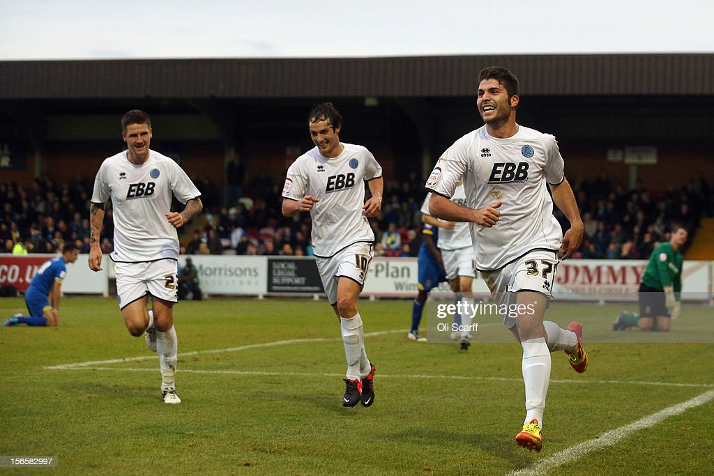 Daniel Lopez (2nd L) of Aldershot Town celebrates scoring during the npower League Two match between AFC Wimbledon and Aldershot Town at the Cherry Red Records Stadium on November 17, 2012 in Kingston upon Thames, England.