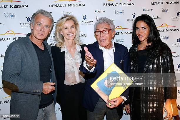 Daniel Lorieux and his companion Laura Restelli standing between Humorist Franck Dubosc and his wife Daniele Dubosc attend JeanDaniel Lorieux signs...