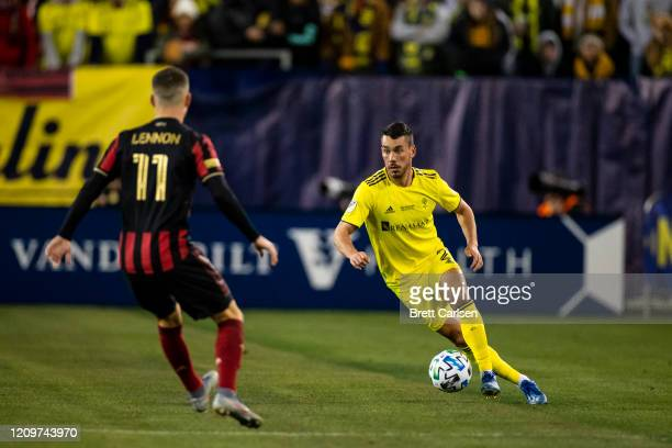 Daniel Lovitz of the Nashville SC moves with the ball against Brooks Lennon of the Atlanta United during the first half at Nissan Stadium on February...