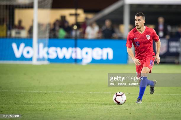 Daniel Lovitz of the United States moves the ball up the pitch with the Volkswagen logo behind him during the International Friendly match between...