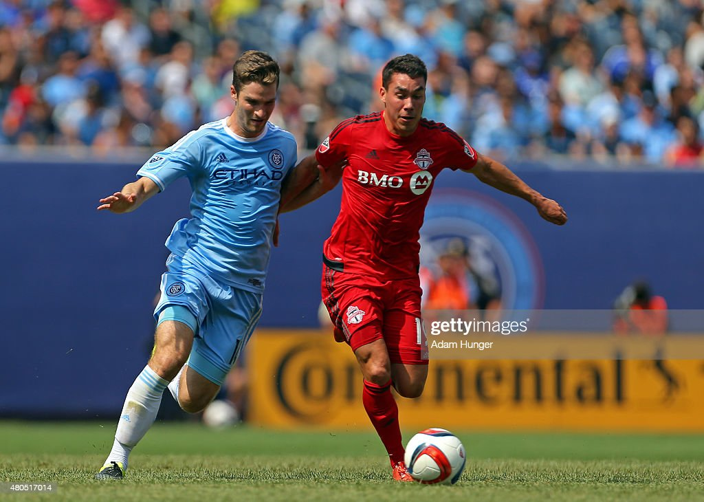 Daniel Lovitz #19 of Toronto FC and Patrick Mullins #14 of New York City FC battle for the ball during a soccer game at Yankee Stadium on July 12, 2015 in the Bronx borough of New York City.