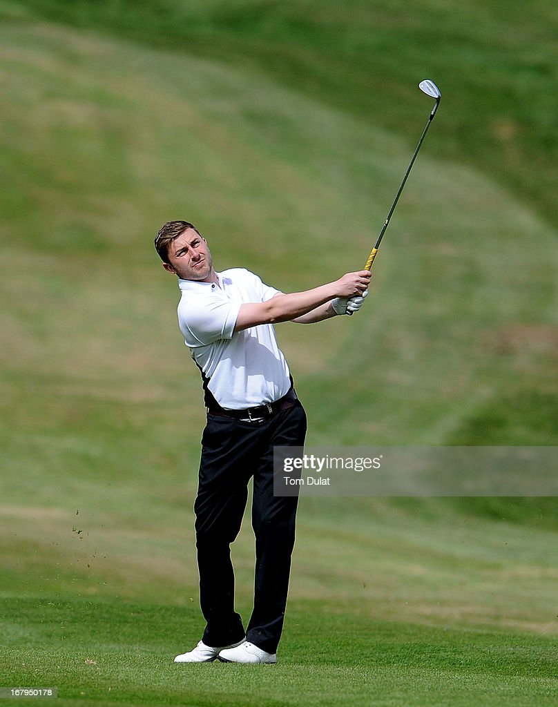 Daniel Lowe of Sandwell Park Golf Club takes a shot from the 16th fairway during the Glenmuir PGA Professional Championship Midland Region Qualifier at Little Aston Golf Club on May 03, 2013 in Sutton Coldfield, England.