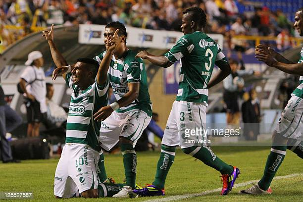 Daniel Luduena of Santos celebrates with teammates a scored goal against San Luis during a match as part of the Apertura 2011 at Alfonso Lastras...