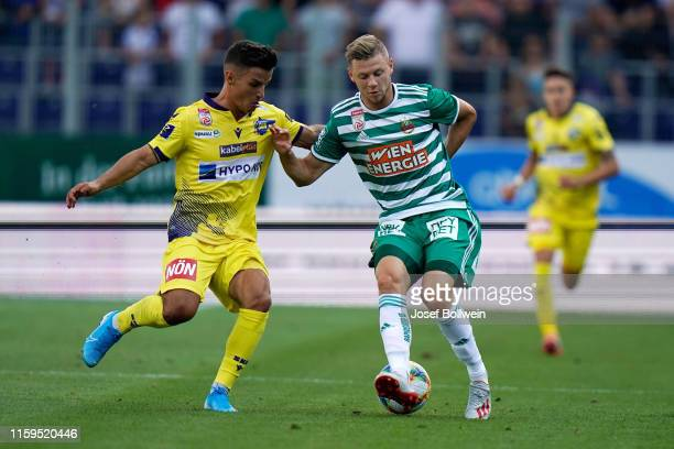 Daniel Luxbacher of St.Poelten and Maximilian Ullmann of Rapid during the tipico Bundesliga match between Spusu SKN St. Poelten and SK Rapid Wien at...