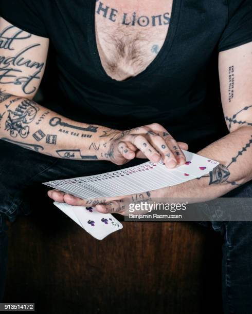 Daniel Madison practices with cards from Chris Ramsay's signature deck in a bar in Manchester England on February 18 2016 The most talented and...