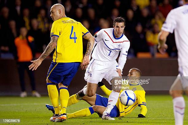 Daniel Majstorovic of Sweden and Robin van Persie of Holland in action during the EURO 2012 Qualifying match between Sweden and Netherlands at the...