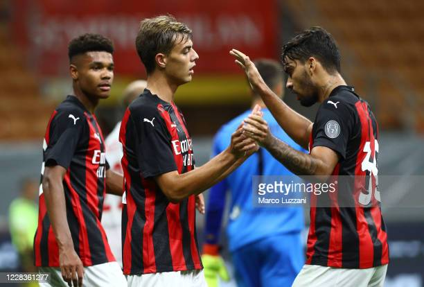 Daniel Maldini of AC Milan celebrates his goal with his team-mate Lucas Paqueta during the pre-season friendly match between AC Milan and Monza at...