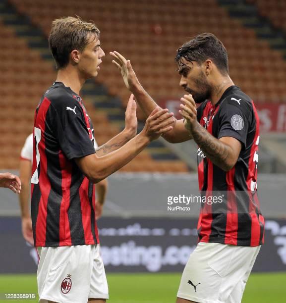 Daniel Maldini of AC Milan celebrates with Lucas Paqueta of AC Milan after scoring the goal during the pre-season friendly match between AC Milan and...