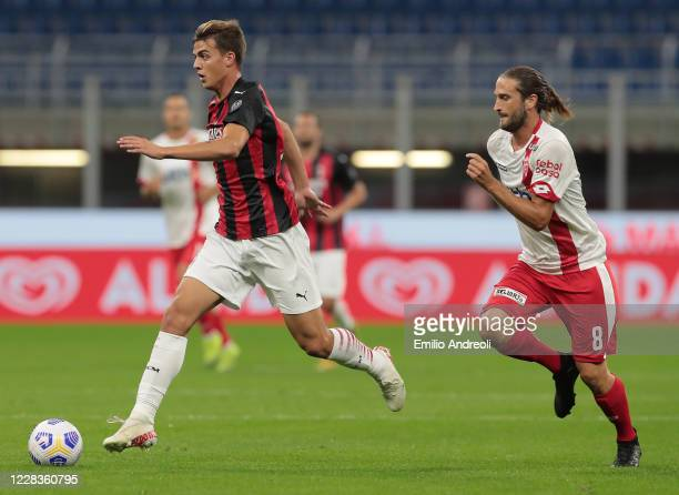 Daniel Maldini of AC Milan is challenged by Andrea Barberis of Monza during the pre-season friendly match between AC Milan and Monza at Stadio...