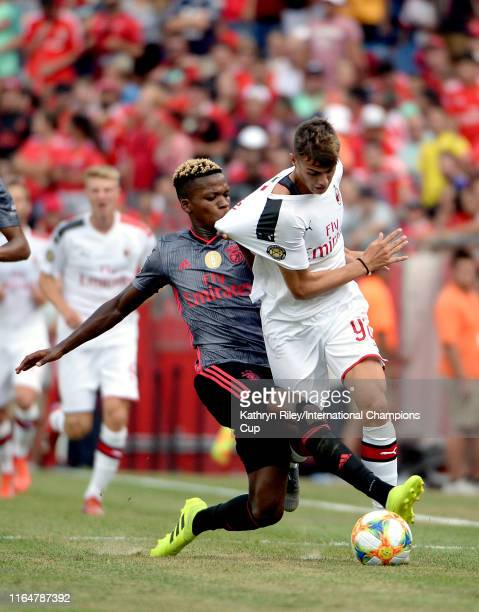 Daniel Maldini of AC Milan is taken down by Florentino Ibrain Morris Luis of Benfica during the International Champions Cup match at Gillette Stadium...
