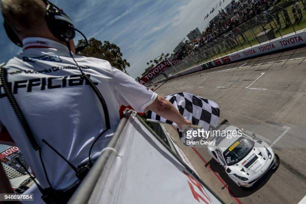 Daniel Mancinelli of Italy drives the Ferrari under the checkered flag to win the Pirelli World Challenge GT race at the Toyota Grand Prix of Long...