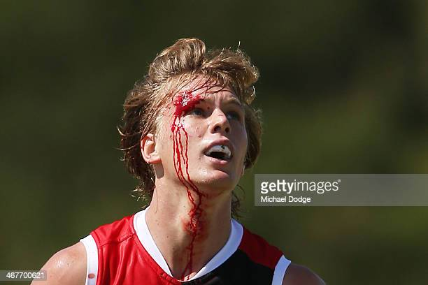 Daniel Markworth looks ahead with blood running down his face during a St Kilda Saints AFL intraclub match at Linen House Oval on February 8 2014 in...