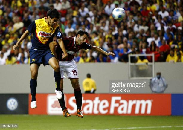 Daniel Marquez of Club America heads the ball into the goal for the game winner against Gianluca Zambrotta of AC Milan during the World Football...