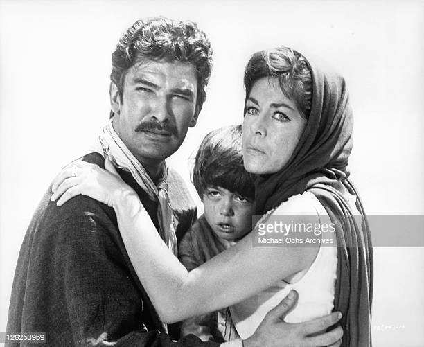Daniel Martin and Marianne Koch hold their baby in a scene from the film 'Fistful of Dollars', 1964.