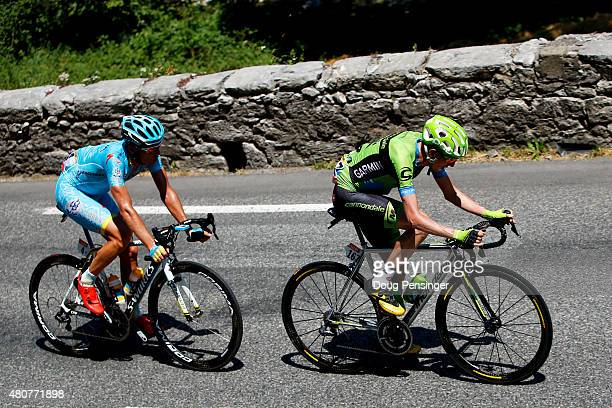 Daniel Martin of Ireland and Team Cannondale-Garmin rides ahead of Andriy Gribko of Ukraine and Astana Pro Team during stage eleven of the 2015 Tour...