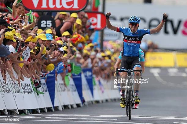 Daniel Martin of Ireland and Team GarminSharp celebrates winning the stage as he crosses the finish line during stage nine of the 2013 Tour de France...