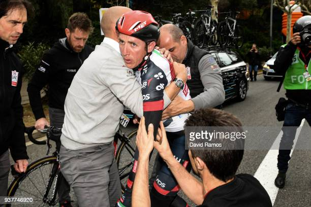 Daniel Martin of Ireland and Team UAE Team Emirates is helped by his team's doctor and stuff members after crashing descending Montjuich during the...