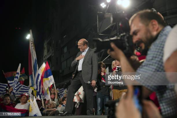 Daniel Martinez presidential candidate for the Broad Front party gestures as he prepares to speak at the party's headquarters during an election...