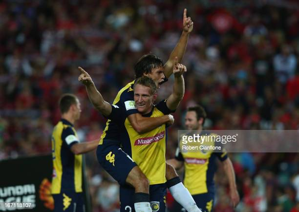 Daniel McBreen and Trent Sainsbury of the Mariners celebrate after the Mariners defeated the Wanderers at the ALeague 2013 Grand Final match between...