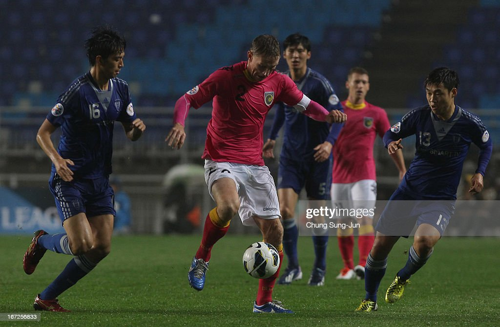 Daniel McBreen of Central Coast Mariners in action with Cho Ji-Hoon and Seo Jung-Jin of Suwon Bluewing during the AFC Champions League Group H match between Suwon Bluewing and Central Coast Mariners at Suwon World Cup Stadium on April 23, 2013 in Suwon, South Korea.