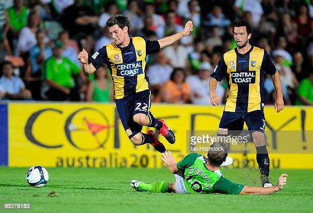 Daniel McBreen of the Fury tackles Nicky Travis of the Mariners during the round 15 ALeague match between North Queensland Fury and the Central Coast...