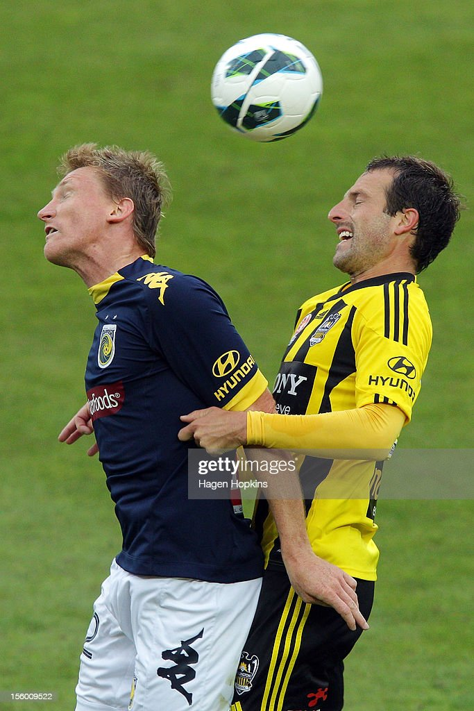 Daniel McBreen of the Mariners and Andrew Durante of the Phoenix compete for a header during the round six A-League match between the Wellington Phoenix and the Central Coast Mariners at Westpac Stadium on November 11, 2012 in Wellington, New Zealand.