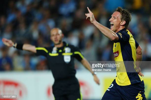 Daniel McBreen of the Mariners celebrates after scoring his first goal against Sydney during the round five ALeague match between the Central Coast...