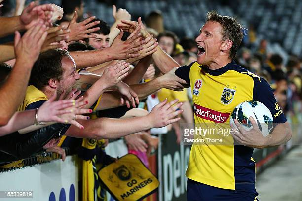 Daniel McBreen of the Mariners celebrates with fans at full time after becoming the first Mariners player to score a hat trick during the round five...