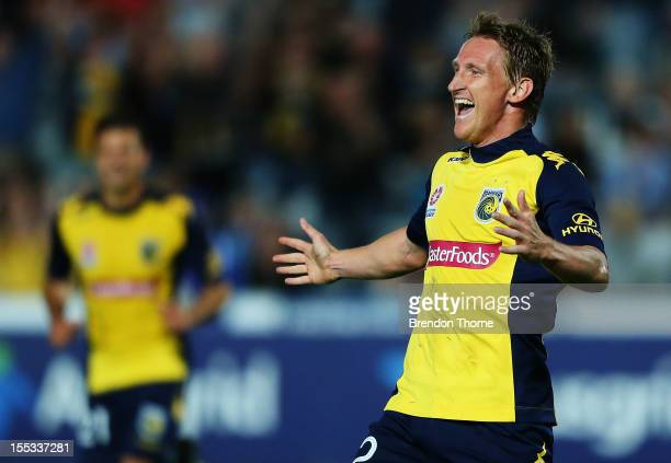 Daniel McBreen of the Mariners celebrates with team mate Pedj Bojic after scoring his first goal against Sydney during the round five ALeague match...