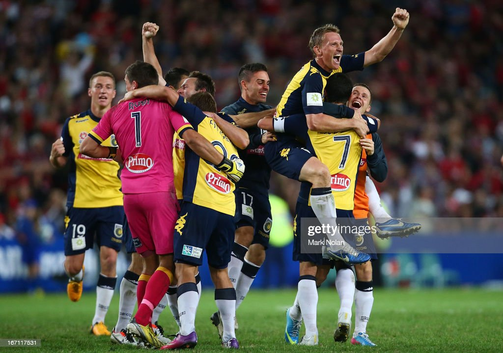 Daniel McBreen of the Mariners celebrates with team mates after winning the A-League 2013 Grand Final match between the Western Sydney Wanderers and the Central Coast Mariners at Allianz Stadium on April 21, 2013 in Sydney, Australia.