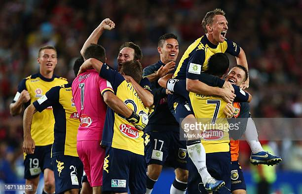 Daniel McBreen of the Mariners celebrates with team mates after winning the ALeague 2013 Grand Final match between the Western Sydney Wanderers and...
