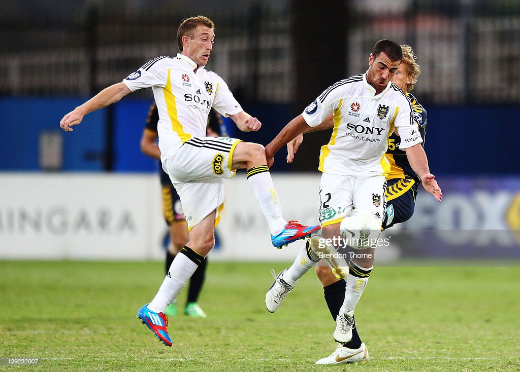 Daniel McBreen of the Mariners competes with Brent Griffiths and Emmanuel Muscat of the Phoenix during the round 20 A-League match between the Central Coast Mariners and the Wellington Phoenix at Bluetongue Stadium on February 18, 2012 in Gosford, Australia.
