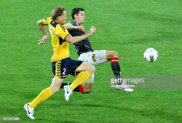 Daniel McBreen of the Mariners is challenged by Brendan Hamill of the Heart during the round 15 A-League match between the Melbourne Heart and the...