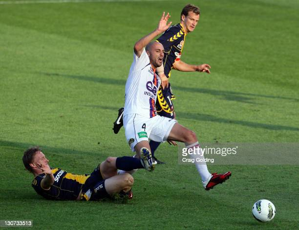 Daniel McBreen of the Mariners is penalised for a tackle on Billy Mehmet of Perth during the round four ALeague match between the Central Coast...