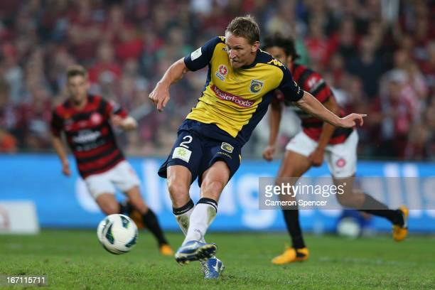 Daniel McBreen of the Mariners kicks a penalty goal during the ALeague 2013 Grand Final match between the Western Sydney Wanderers and the Central...