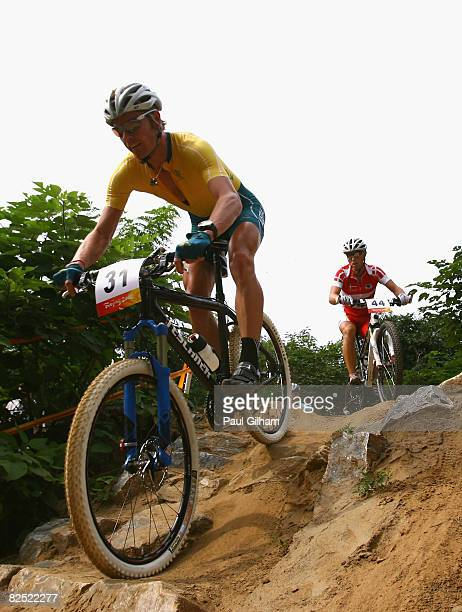 Daniel McConnell of Australia and Klaus Nielsen of Denmark compete in the Men's Cross Country mountain bike cycling event held at the Laoshan...