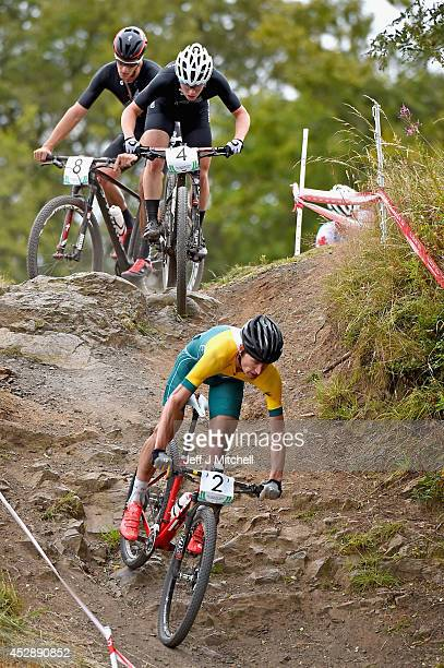 Daniel McConnell of Australia leads Anton Cooper and Samuel Gaze of New Zealand during the Mountain Biking at Cathkin Braes Mountain Bike Trails...
