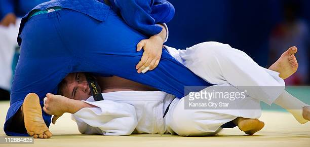 Daniel McCormick of the United States bottom battles Djegui Bathily of Senegal in 100kg judo action on Friday August 15 during the games of the XXIX...