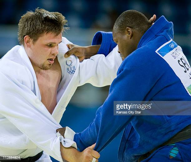Daniel McCormick of the United States left battles Djegui Bathily of Senegal in 100kg judo action on Friday August 15 during the games of the XXIX...