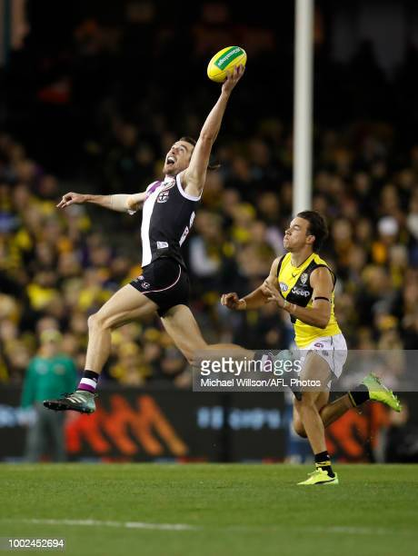 Daniel McKenzie of the Saints and Daniel Rioli of the Tigers in action during the 2018 AFL round 18 match between the St Kilda Saints and the...