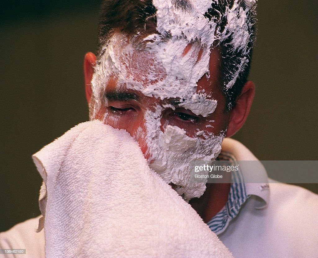 Man Wipes His Face After Being Hit With A Pie : News Photo