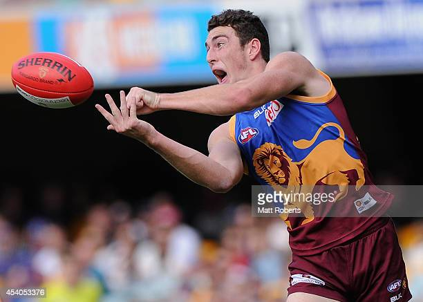 Daniel McStay of the Lions handballs during the round 22 AFL match between the Brisbane Lions and the Fremantle Dockers at The Gabba on August 24...