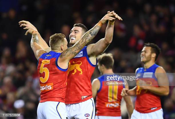 Daniel McStay of the Lions is congratulated by Mitch Robinson after kicking a goal during the round 14 AFL match between the St Kilda Saints and the...