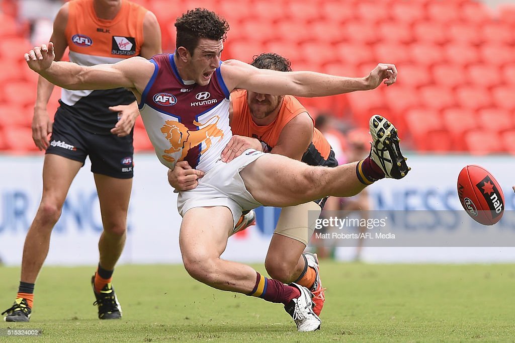 Daniel McStay of the Lions kicks at the ball during the NAB Challenge AFL match between the Brisbane Lions and the Greater Western Sydney Giants at Metricon Stadium on March 13, 2016 in Gold Coast, Australia.