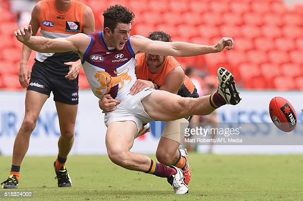 Daniel McStay of the Lions kicks at the ball during the NAB Challenge AFL match between the Brisbane Lions and the Greater Western Sydney Giants at...